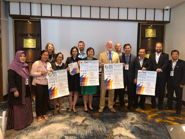 Aimee T. Gonzales, four PEMSEA country representatives, Mr. Peter Thomson, Mr. Kristian Teleki, and the GEF officials pose with EAS Congress 2018 posters